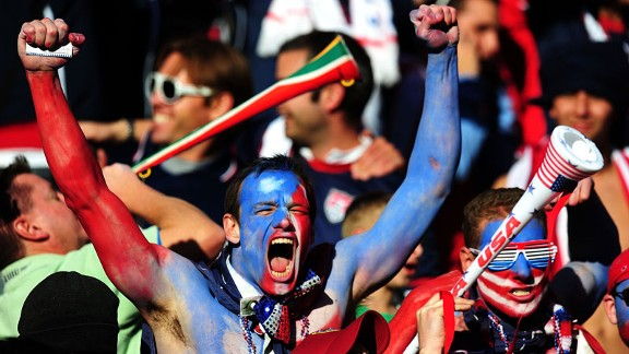A USA fan cheers in delight