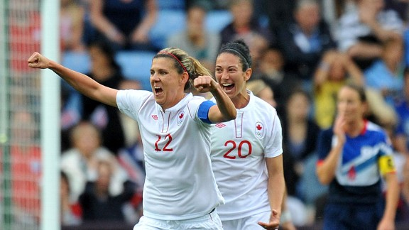 Christine Sinclair celebrates scoring Canada's second goal in Coventry