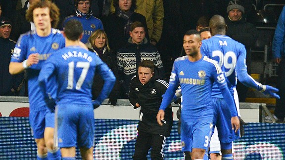 Eden Hazard looks at the injured ballboy