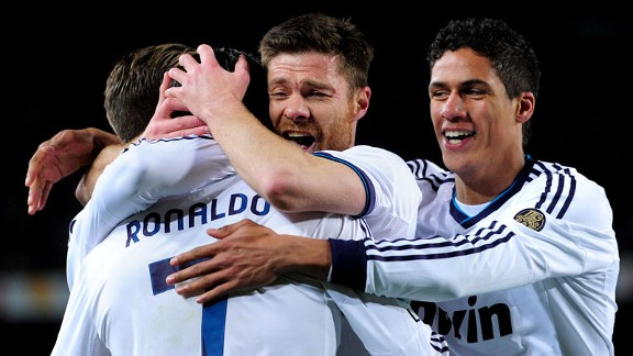 Cristiano Ronaldo celebrates with his team-mates after doubling Real Madrid's lead at the Camp Nou