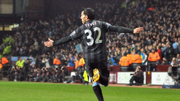 Carlos Tevez wheels away in delight after scoring the goal which led Man City to victory at Aston Villa