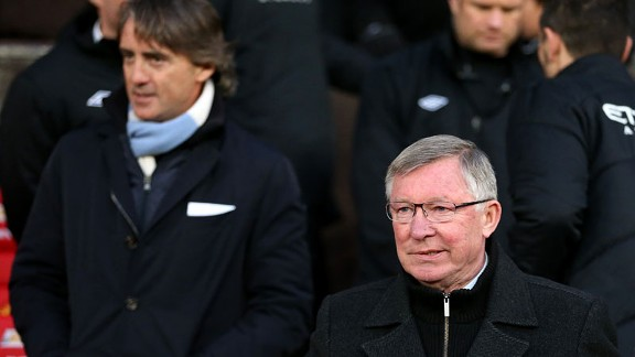 Sir Alex Ferguson Roberto Mancini on the touchline at Old Trafford