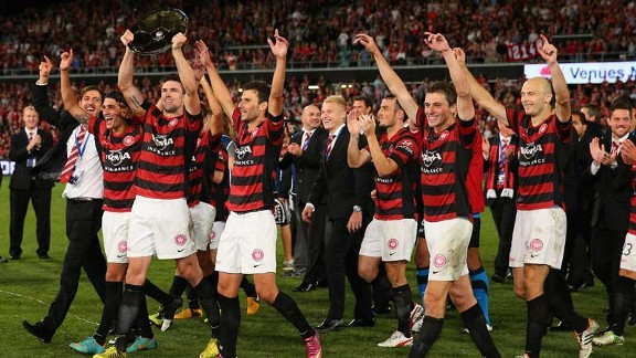 Western Sydney Wanderers captain Michael Beauchamp holds the Premiers' Plate after the victory over Brisbane Roar