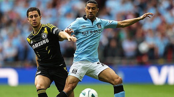 Gael Clichy challenges Eden Hazard in the FA Cup semi-final between City and Chelsea