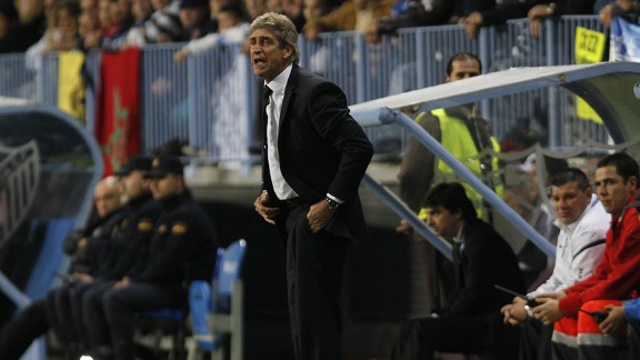 Malaga boss Manuel Pellegrini has been linked with both Manchester City and Real Madrid