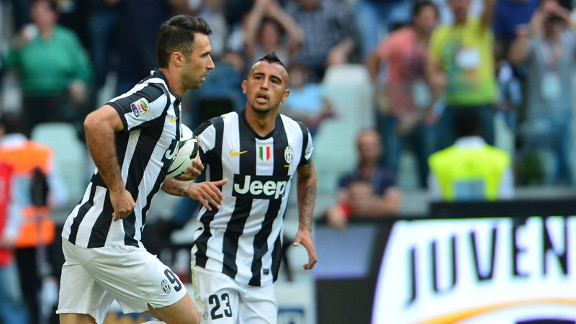Mirko Vucinic celebrates after netting an equaliser for Juventus