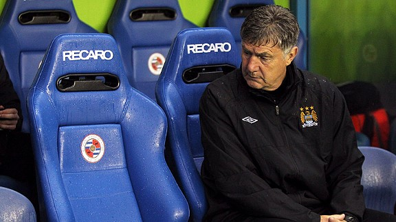 Brian Kidd is a lonely figure as he glances across the Man City bench