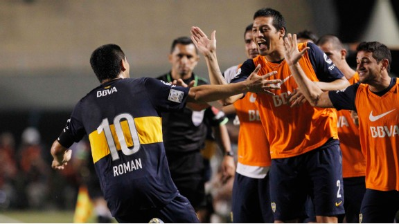 Boca Juniors' Roman Riquelme celebrates with his teammates after scoring against Corinthians.