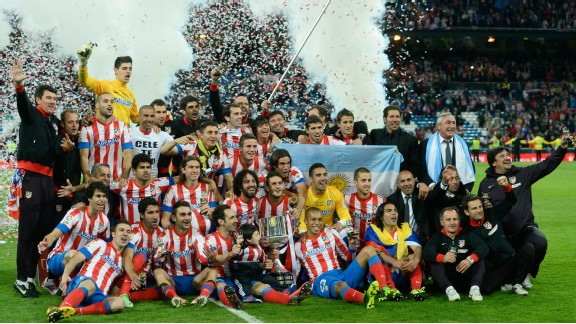 Atletico Madrid players celebrate after their 2-1 Copa del Rey final win over Real Madrid