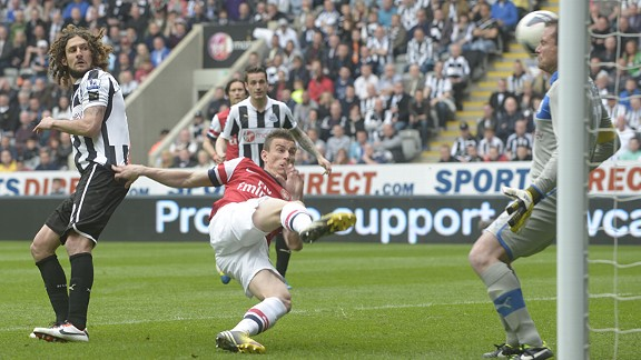 Laurent Koscielny volleys Arsenal into the lead at Newcastle