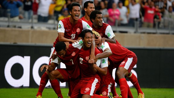 Tahiti players celebrate their Confederations Cup goal against Nigeria