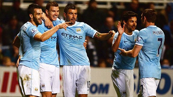 Man City celebrate after Edin Dzeko scored their second extra-time goal at Newcastle.