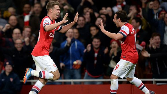 Aaron Ramsey and Santi Cazorla celebrate during Arsenal's Premier League game against Liverpool.