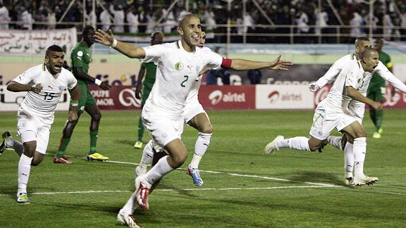 Madjid Bougherra celebrates after his goal sent Algeria to the World Cup finals.