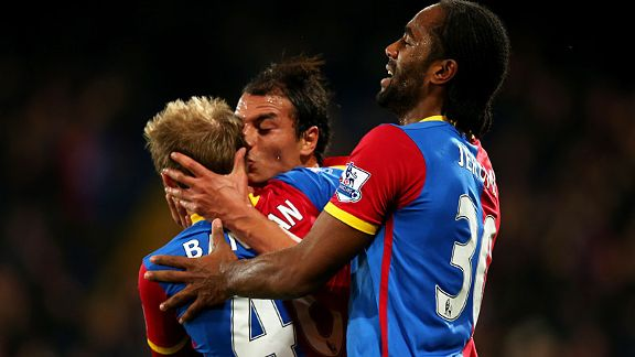 Marouane Chamakh plants a kiss on Barry Bannan after scoring Palace's winner.
