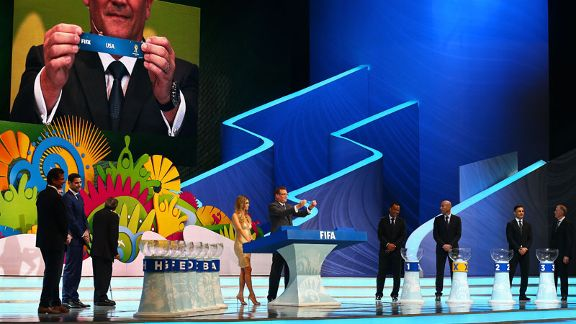 FIFA secretary general Jerome Valcke holds up the name of USA during the 2014 World Cup draw.