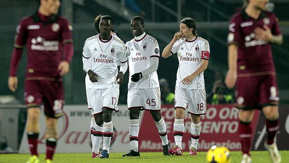 AC Milan's Mario Balotelli (centre) celebrates after scoring against Livorno.