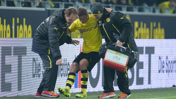 Sven Bender receives treatment during Dortmund's defeat against Leverkusen.