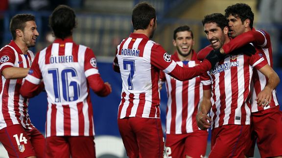 Raul Garcia (second from right) celebrates his opener for Atletico Madrid.