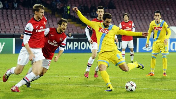 Gonzalo Higuain fires home to put Napoli 1-0 up against Arsenal.