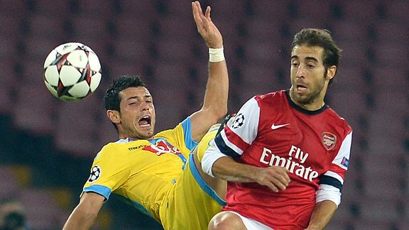 Napoli's Swiss midfielder Blerim Dzemaili (L) battles with Mathieu Flamini.