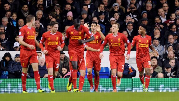 Liverpool players celebrate a goal during their 5-0 victory against Tottenham.