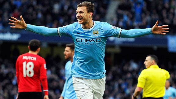 Edin Dzeko celebrates after putting Manchester City into the lead against Cardiff City.