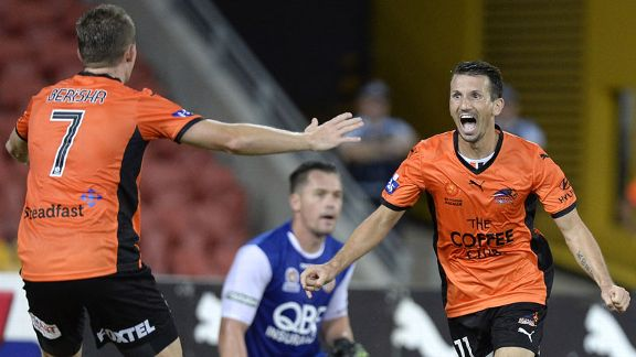 Liam Miller celebrates his goal in Brisbane Roar's victory.