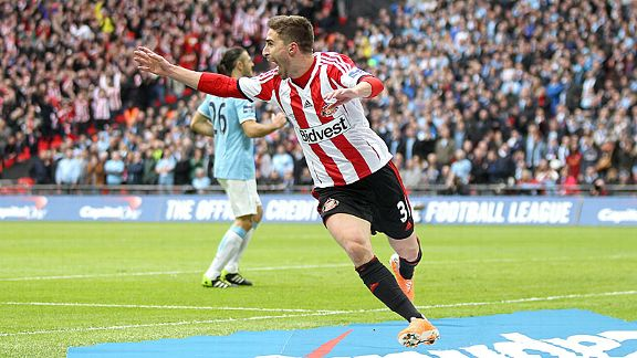 Fabio Borini celebrates after putting Sunderland in front against Manchester City.