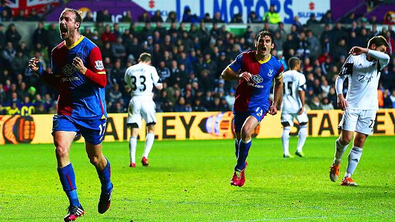 Glenn Murray (l) celebrates after scoring from the spot to earn Palace a point at Swansea.