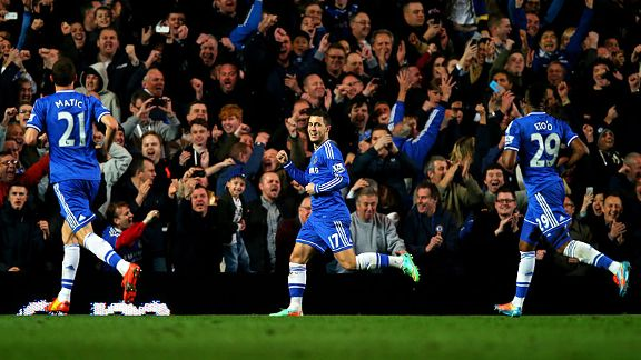 Chelsea celebrate after Eden Hazard scored from the spot against Spurs.