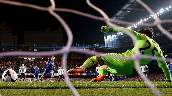 Eden Hazard sends Hugo Lloris the wrong way to double Chelsea's lead against Spurs.