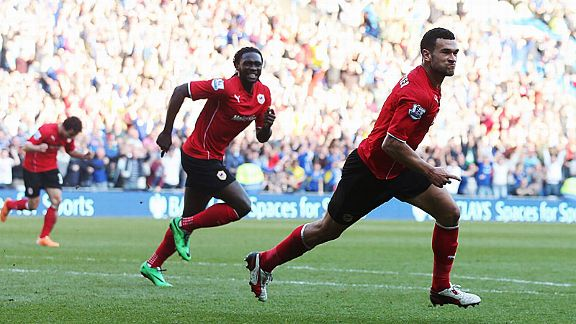 Steven Caulker celebrates after scoring his second goal for Cardiff against Fulham.