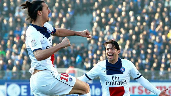 Zlatan Ibrahimovic celebrates with Maxwell after giving PSG the lead at Bastia.