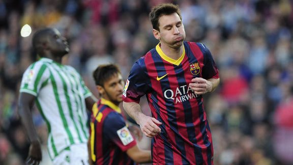 Lionel Messi scored twice for Barcelona as they edged past Real Betis.