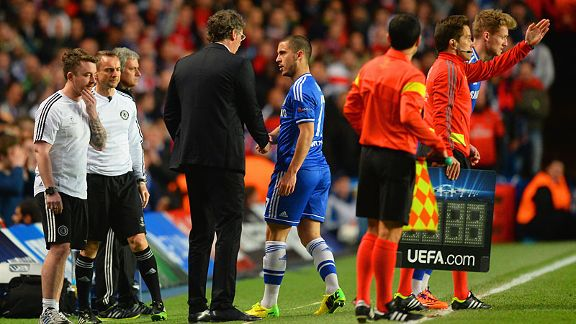 PSG boss Laurent Blanc shakes hands with transfer target Eden Hazard after he was forced off injured.