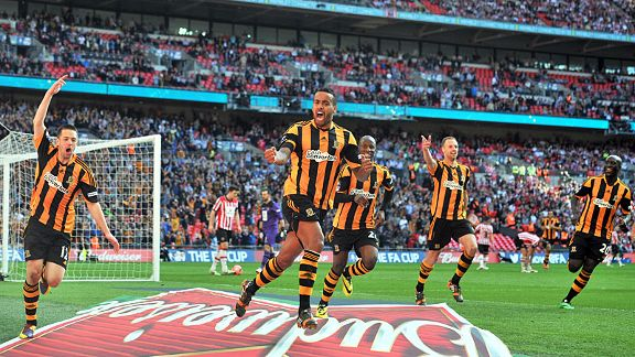 Tom Huddlestone leads the celebrations after giving Hull the lead against Sheffield United.