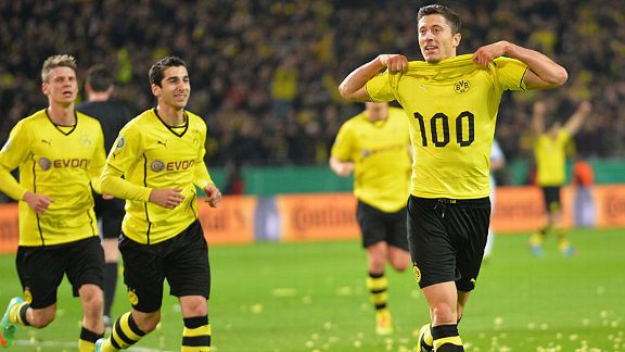 Robert Lewandowski celebrates his 100th Dortmund goal in the DFB-Pokal semifinal against VfL Wolfsburg.