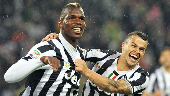 Goalscorer Paul Pogba celebrates with Sebastian Giovinco after netting the winner against Bologna.