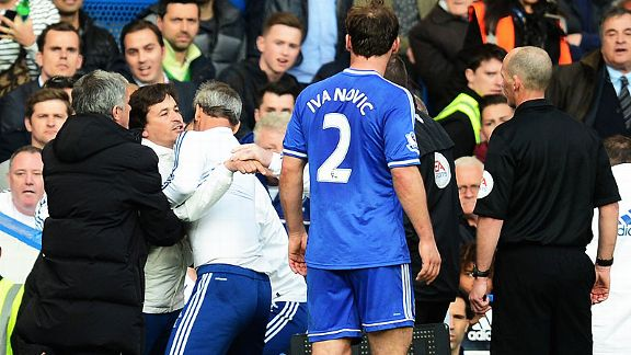 Chelsea coach Rui Faria is pulled away from referee Mike Dean after reacting angrily to Sunderland's winning penalty.
