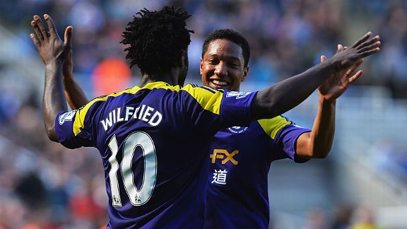 Jonathan de Guzman celebrates with goalscorer Wilfried Bony after he headed home Swansea's leveller at Newcastle.
