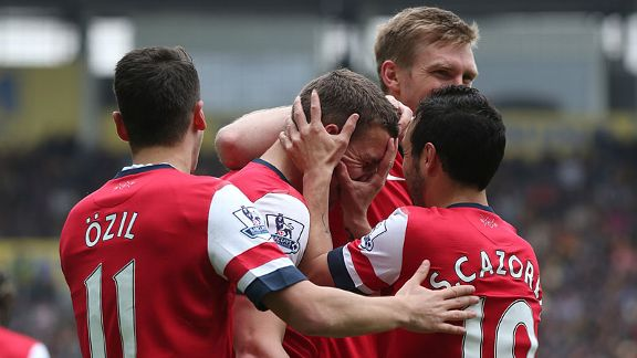 Arsenal celebrate after taking a 3-0 lead through Lukas Podolski.