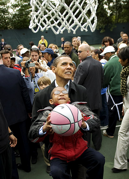 Obama helping young boy