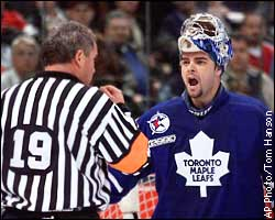 Curtis Joseph, referee Mick McGeough