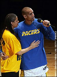 Cheryl and Reggie Miller