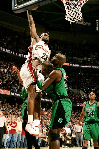 LeBron James dunks over Kevin Garnett