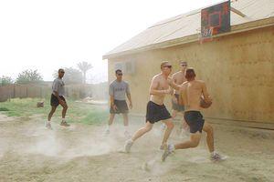 American Infantrymen play basketball in Iraq.