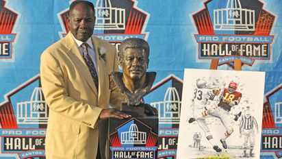 Kansas City Chiefs former cornerback Emmitt Thomas with his bust and
