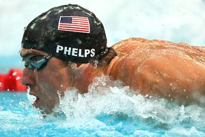 Michael Phelps leaves rivals trailing in his wake on his way to smashing his own 200 IM world record and placing him within two gold medals of breaking Mark Spitzs record of seven at a single Games.