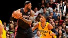 LeBron James #6 of the Miami Heat controls the ball against Paul George #24 of the Indiana Pacers on March 10, 2013 at American Airlines Arena in Miami, Florida. w/ Grantland NBA Playoffs Logo
